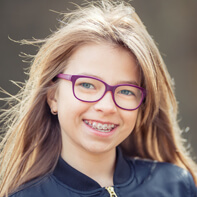 Preteen girl with traditional braces