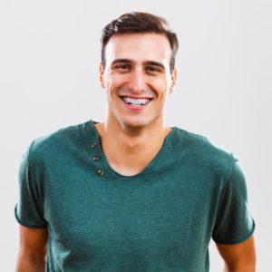 man smiling while wearing braces