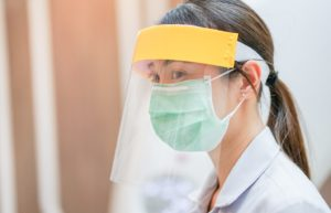 orthodontic team member wearing mask and face shield